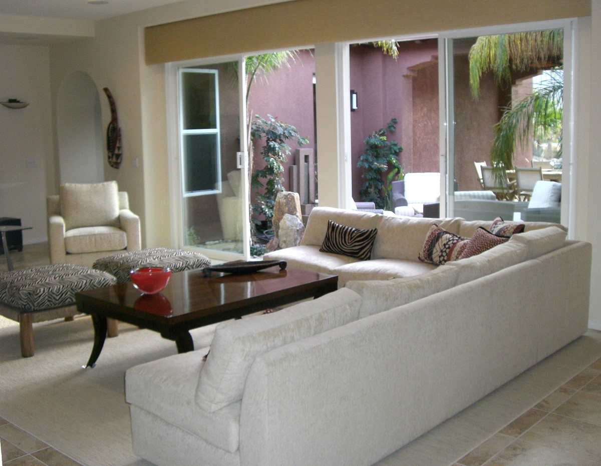The Large Living Room Has Ample Seating For Guests With A Media Center Featuring HDTV And Flat Panel TV DVD System